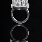 A sterling silver ring with square stock spikes and square stock shank.