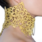 Metal lace high collar with hinged back and fabricated needle front clasp with freshwater pearl chain.